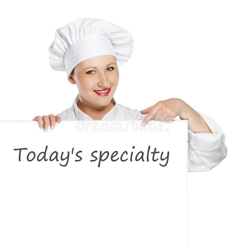 Cocinero de sexo femenino joven con la bandera del espacio de la copia imagen de archivo
