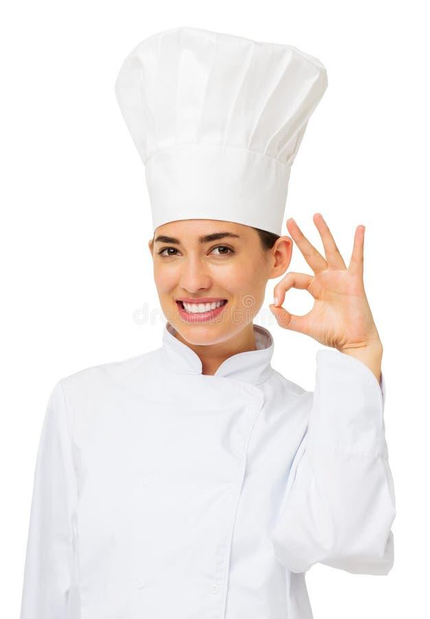 Cocinero de sexo femenino Making Ok Gesture fotografía de archivo