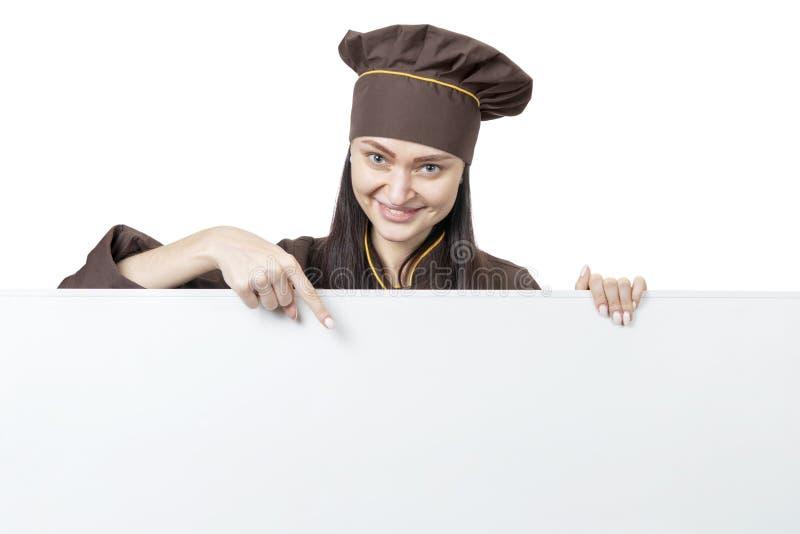 Cocinero de sexo femenino que señala abajo fotografía de archivo