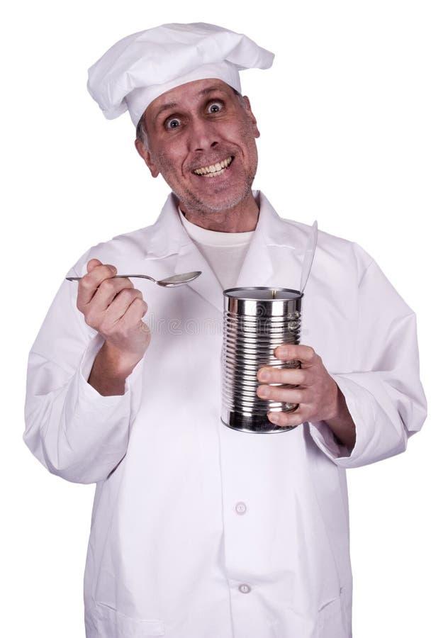 Cocinero de sexo masculino divertido del cocinero que come de la poder de estaño aislada imágenes de archivo libres de regalías