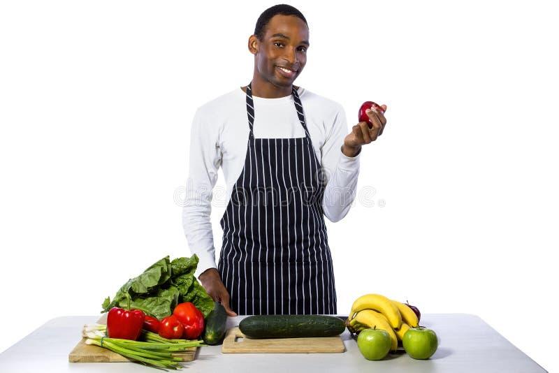 Cocinero de sexo masculino en un fondo blanco fotografía de archivo libre de regalías