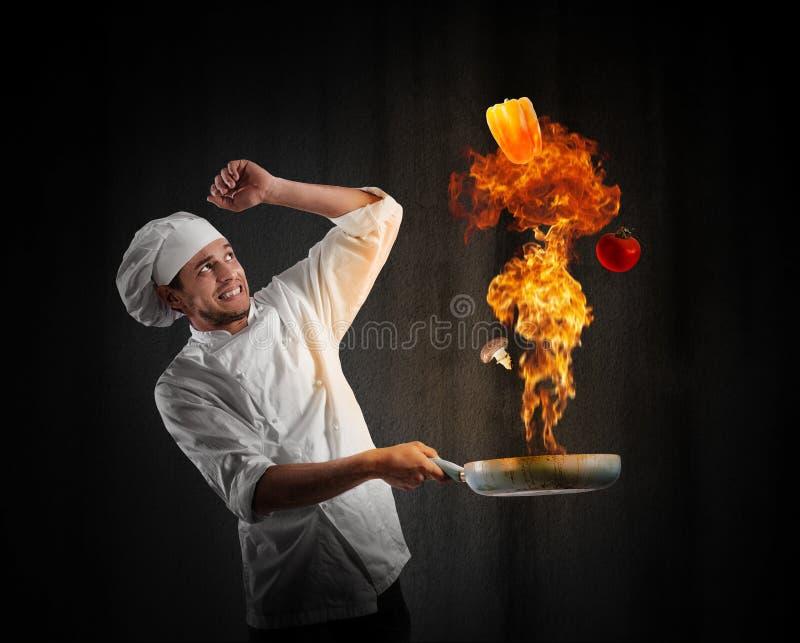Cocinero del cocinero con problema en cocina fotografía de archivo libre de regalías