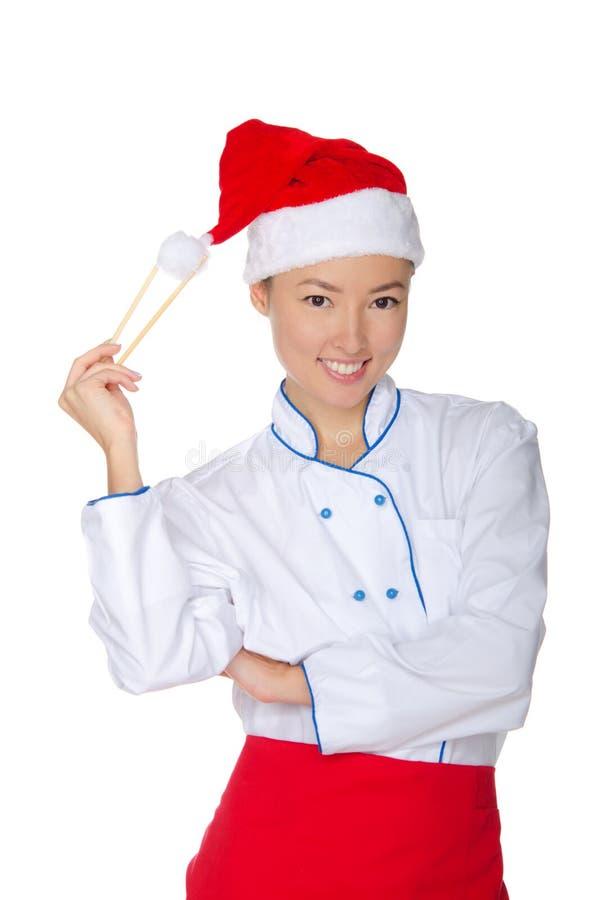 Cocinero del este que sostiene el casquillo de la Navidad de los palillos imagen de archivo