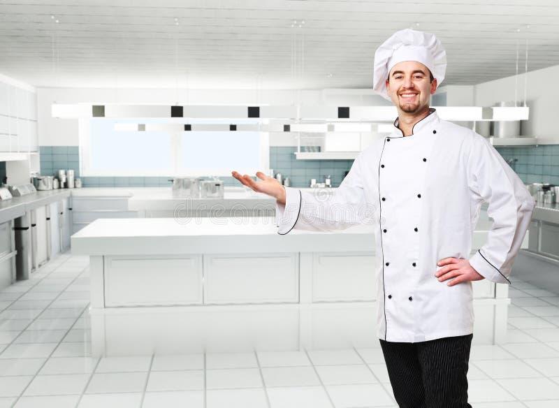Cocinero en cocina foto de archivo