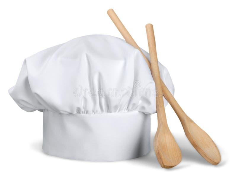 Cocinero Hat con las cucharas de madera foto de archivo