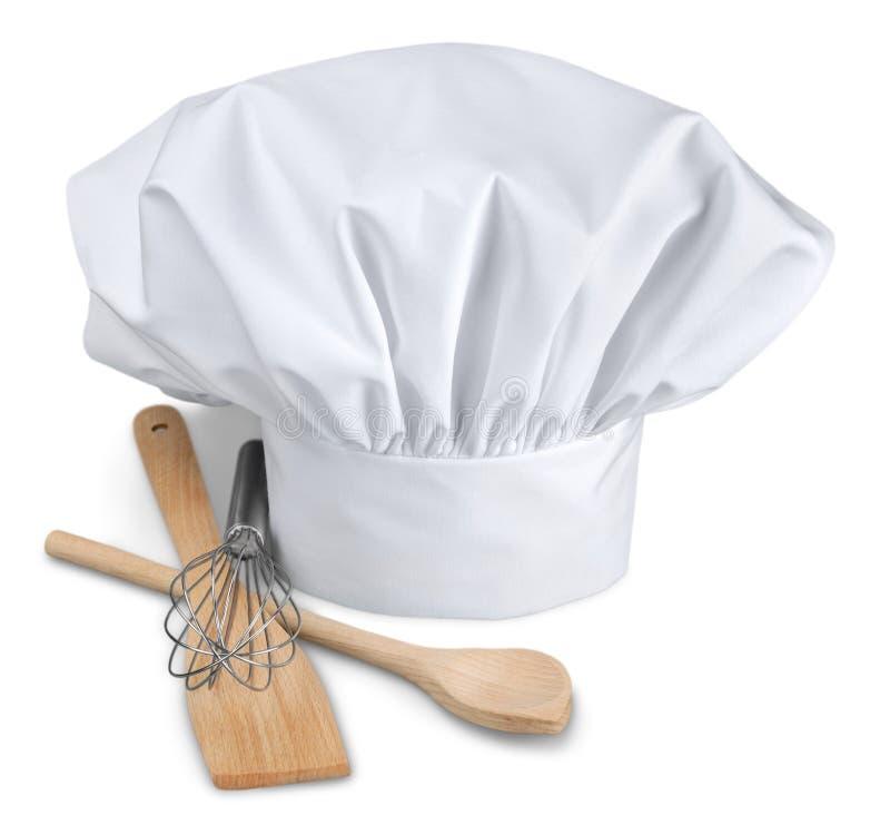 Cocinero Hat con los utensilios de cocinar fotos de archivo