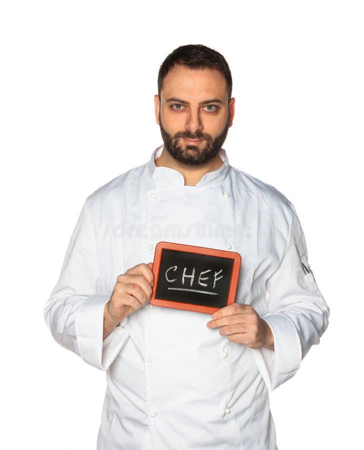 Cocinero joven con la pizarra foto de archivo