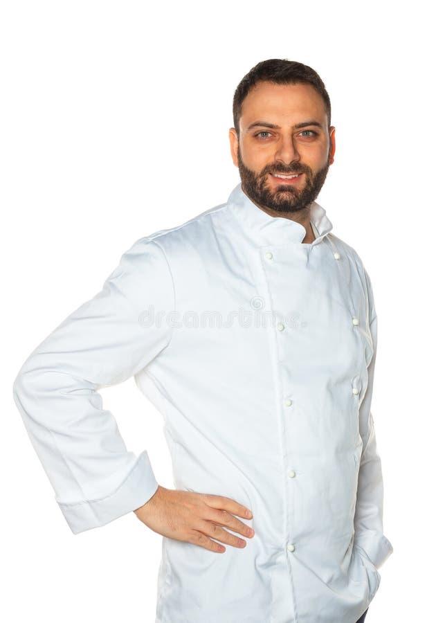 Cocinero joven en el fondo blanco imagen de archivo