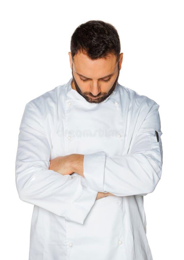 Cocinero joven que duerme en el fondo blanco fotos de archivo