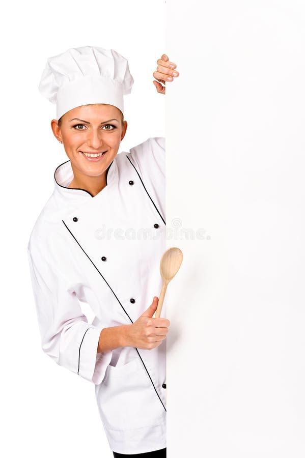 Cocinero, panadero o cocinero de la mujer llevando a cabo el pape blanco en blanco fotografía de archivo