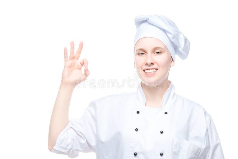 Cocinero que gesticula en el fondo blanco, todo el gesto de la autorización fotos de archivo
