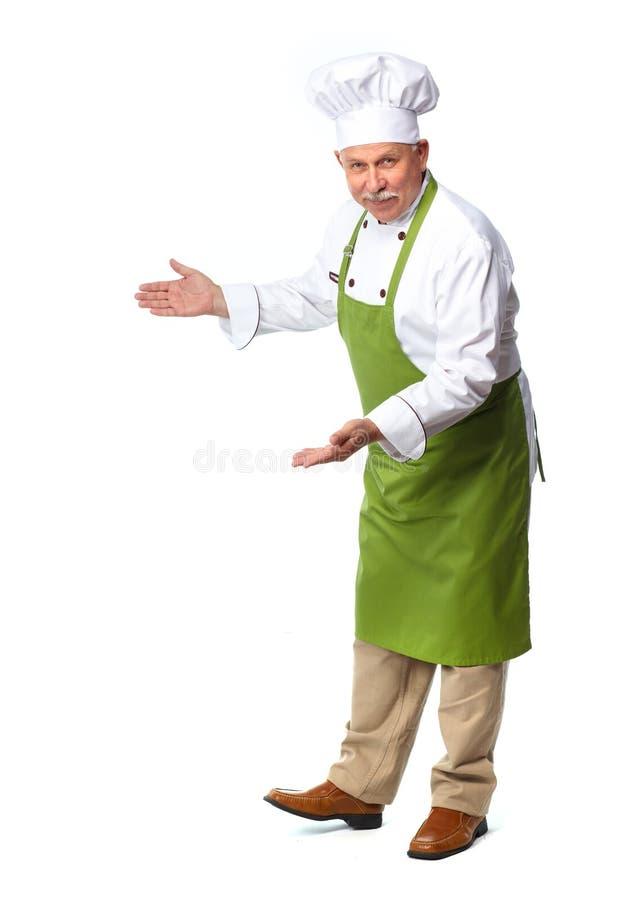 Cocinero que invita en restaurante. imagenes de archivo