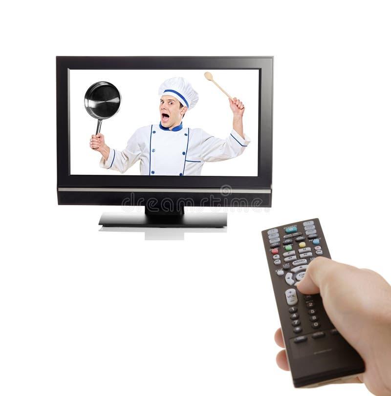 Cocinero que lucha para escaparse por dentro de una TV imagen de archivo libre de regalías