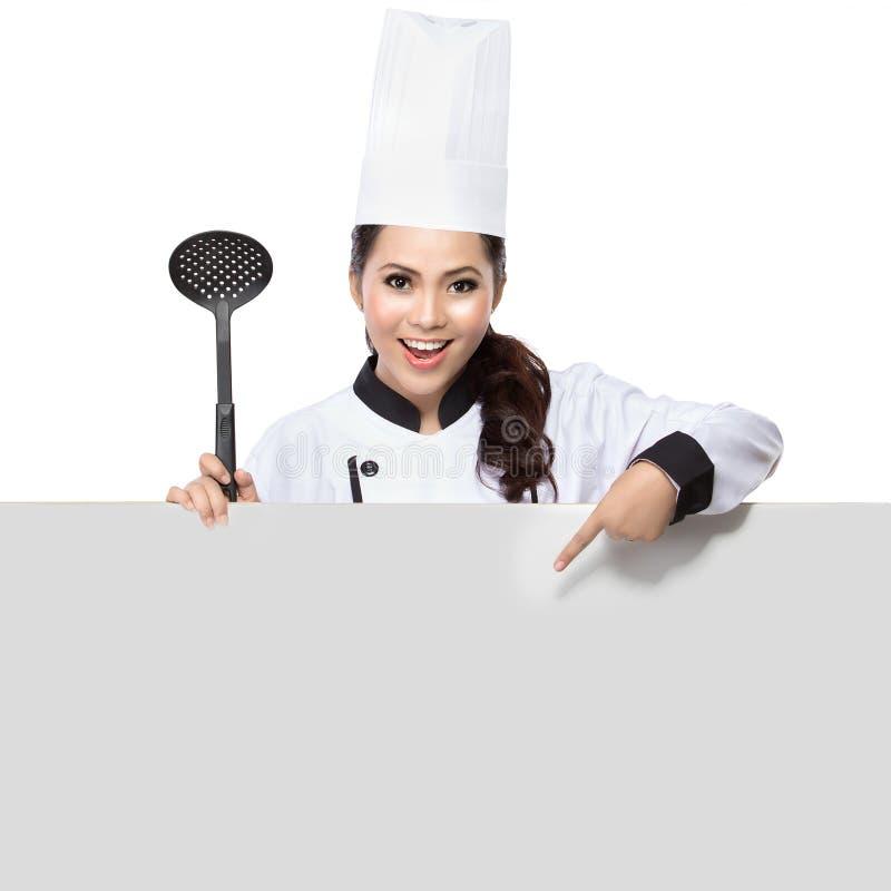 Cocinero que muestra la muestra en blanco imagen de archivo
