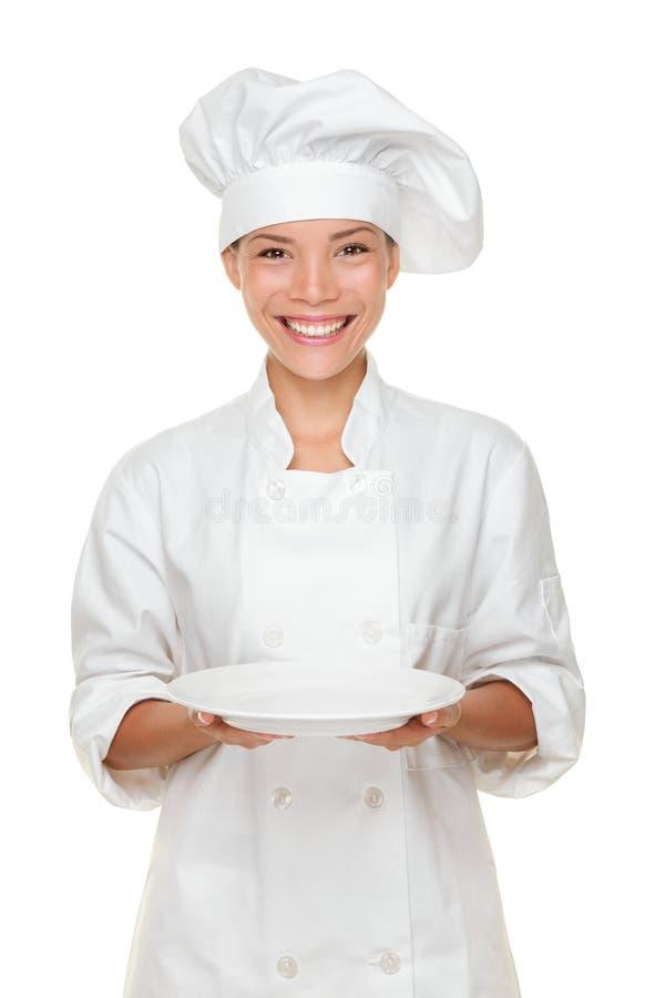 Cocinero que muestra la placa vacía fotos de archivo