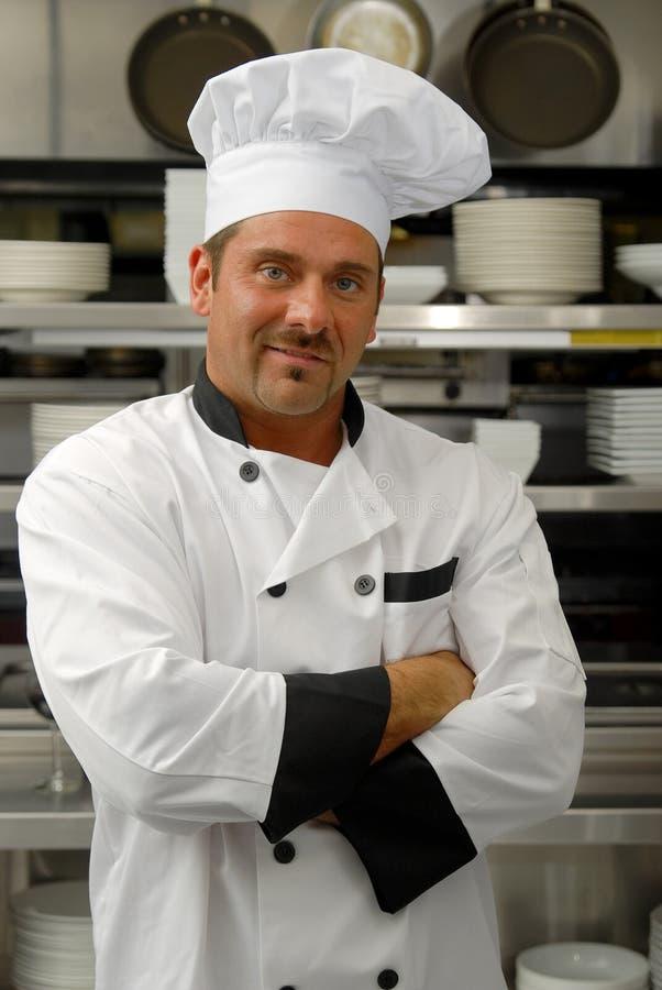 Cocinero sonriente en uniforme imagen de archivo libre de regalías
