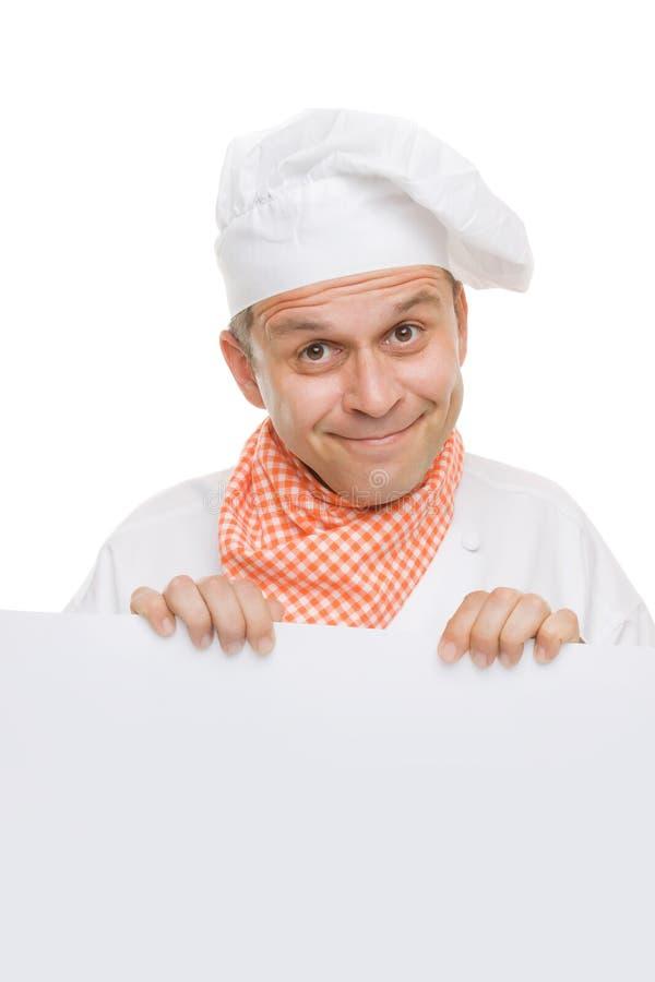 Cocinero sonriente que lleva a cabo a la tarjeta blanca del Info foto de archivo