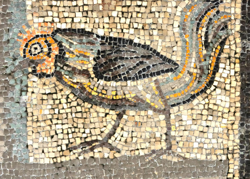 The. Ancient roman mosaic of a cockerel (or cock) on the UNESCO listed floor of the Aquileia basilica in Italy stock image