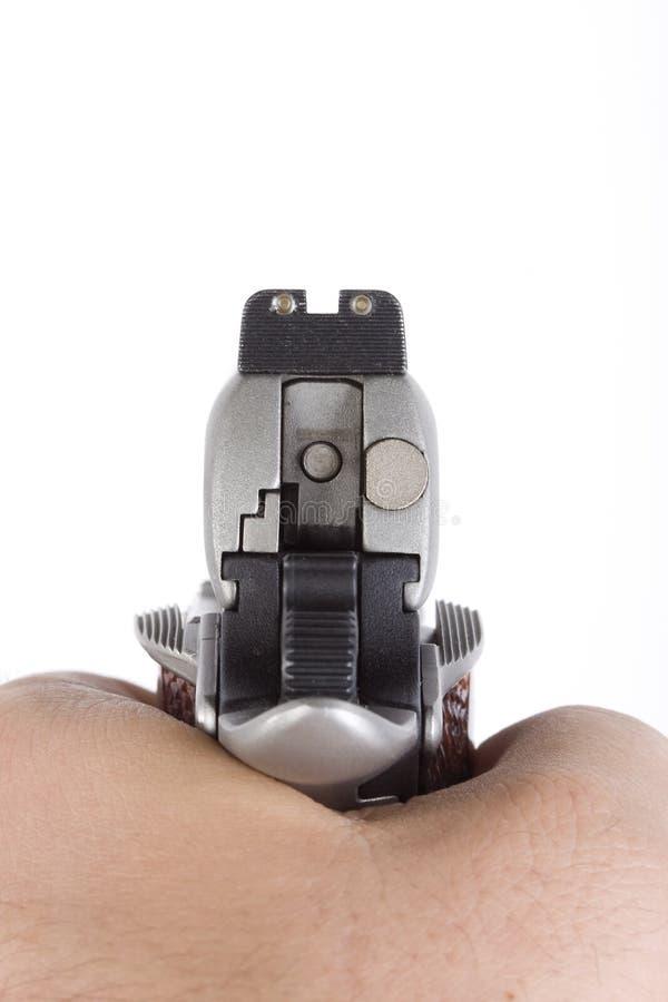 Cocked hand gun royalty free stock image