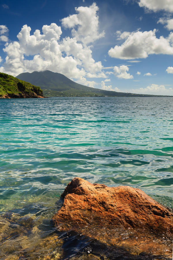 Cockleshell Bay. The view from Cockleshell Bay on the Caribbean island of St. Kitts in the West Indies. The island of Nevis can be seen in the background stock image