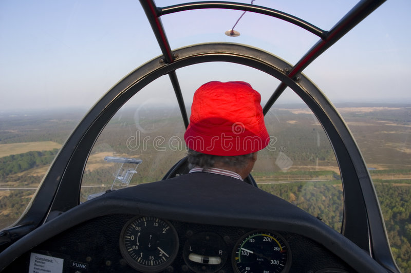 Cockpit. View into a cockpit of a glider with the pilot stock images