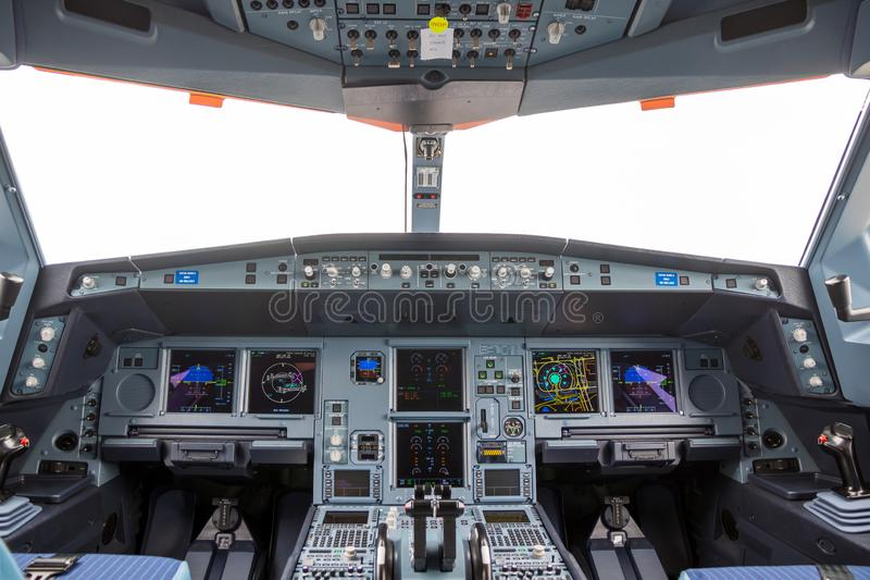 Cockpit Airbus A330neo passenger plane. LE BOURGET PARIS - JUN 20, 2019: Cockpit view of the Airbus A330neo passenger plane on display at the Paris Air Show stock images