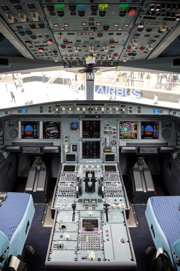 Cockpit Airbus A330neo passenger plane. LE BOURGET PARIS - JUN 20, 2019: Cockpit view of the Airbus A330neo passenger plane on display at the Paris Air Show royalty free stock images