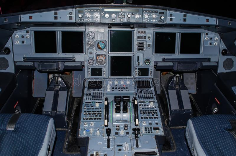 Cockpit of the aircraft pilots is in a state Cold and Dark. Cockpit of the aircraft pilots is in a state Cold and Dark stock photography