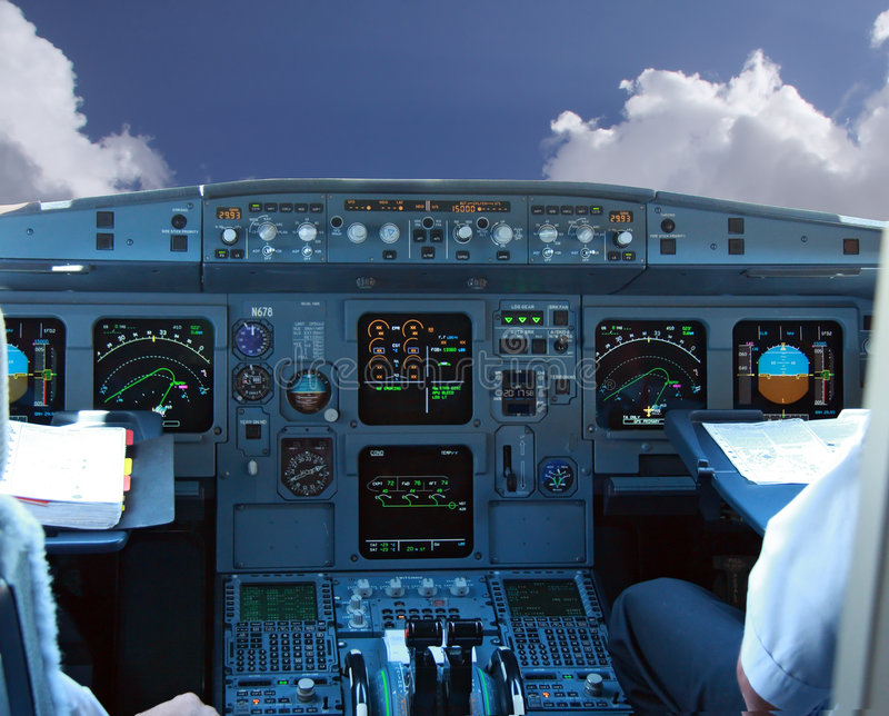 COCKPIT IN AIRLINER. With blue sky stock photos