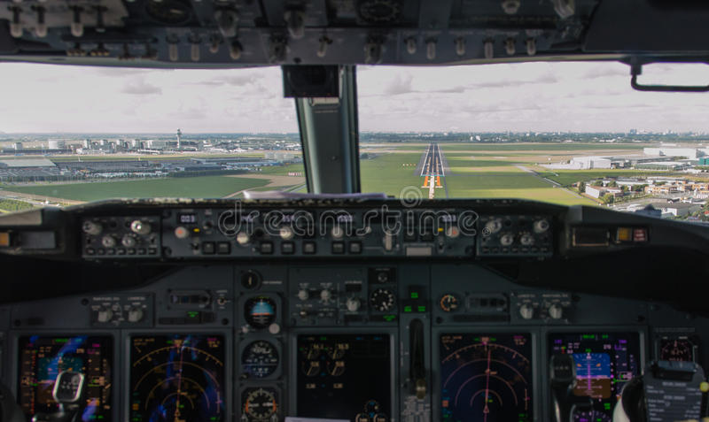 Cockpit Approach. Cockpit view of an airliner about to land on final approach stock image