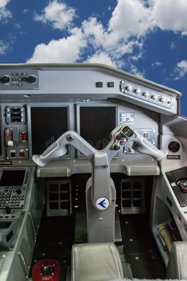 Cockpit of Embraer 175. Close up of joystick of cockpit (cloches stock images