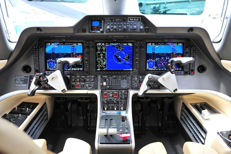 Cockpit of an Embraer Phenom 300 business jet at Singapore Airshow. SINGAPORE - FEBRUARY 12: Cockpit of an Embraer Phenom 300 business jet at Singapore Airshow royalty free stock photography