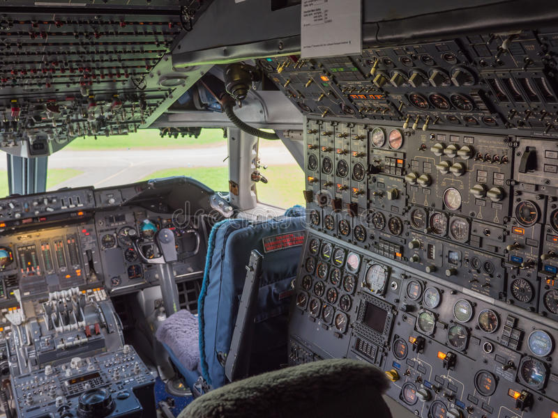 Cockpit of a jumbo jet. View inside the cockpit of a jumbo jet airliner royalty free stock photography