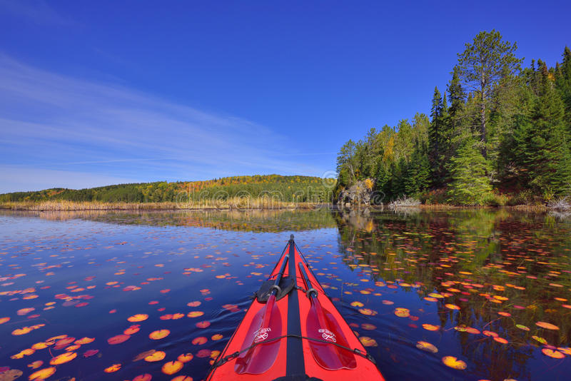 Fall color from cockpit of kayak stock photography