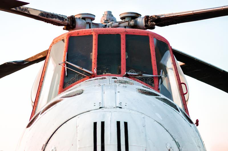 Cockpit of an old vintage helicopter with blades. Close up royalty free stock images