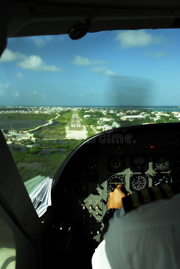Cockpit view of plane landing in belize stock image