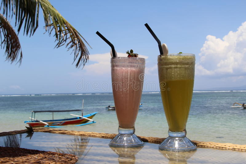Cocktail on a beach in Bali royalty free stock images