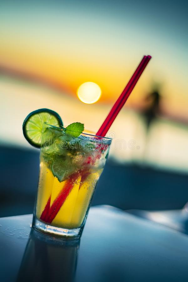Cocktail on the beach .. sunset stock photos