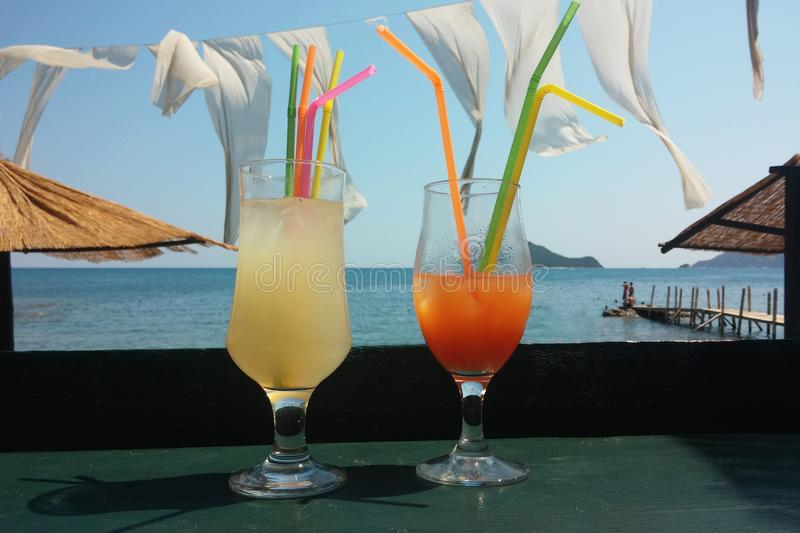 Cocktail on the beach. Two glasses of juice cocktail on the beach stock photo