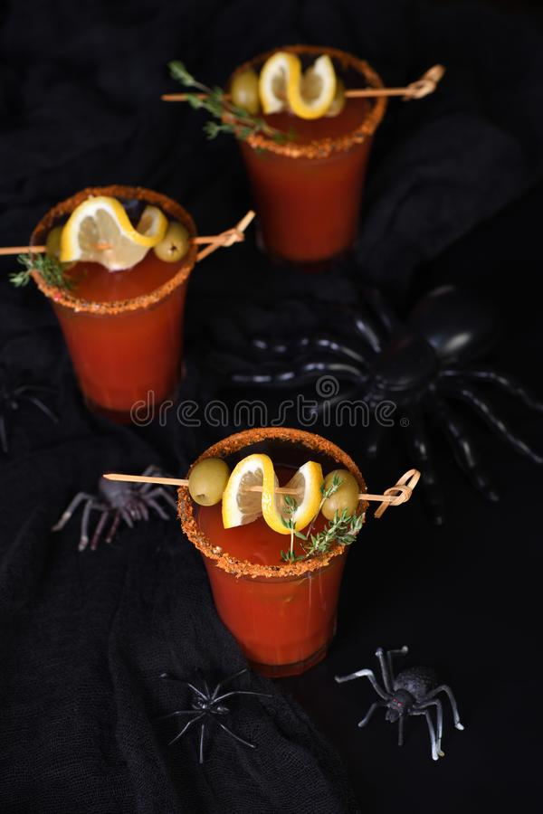Cocktail  Bloody Mary for a Halloween party. Michelada - Mexican alcoholic cocktail, tomato juice, spicy sauce and spices. Great idea for a Halloween party royalty free stock photo