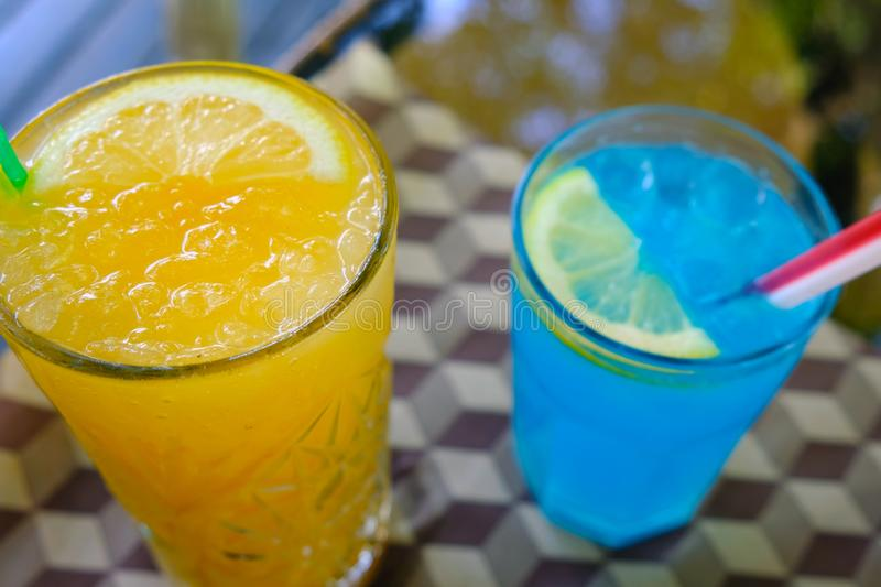 Cocktail blue lagoon and fresh orange with ice. stock photo