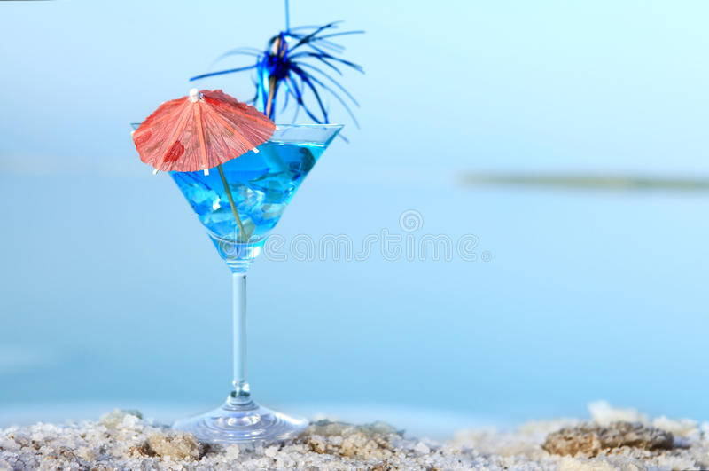 Cocktail blue summer sea. Relaxing cocktail blue summer sea royalty free stock image