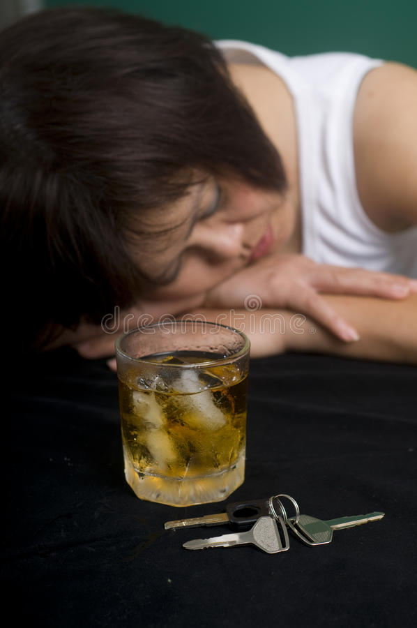 Cocktail and car keys stock image