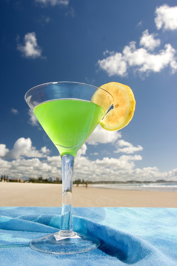 Cocktail Close-up. Close-up of Cocktail with Lime and dramatic sky royalty free stock photo