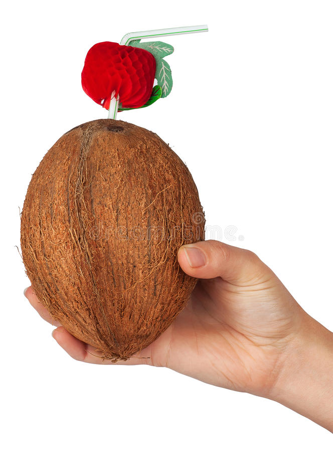 Cocktail in a coconut with a straw in a woman's hand stock photos