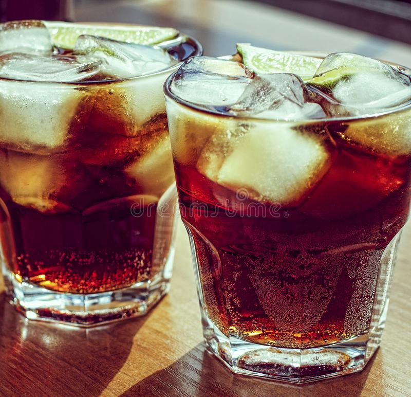 Summer drink, cube, cola, brown, drink, cocktail, rum, glass, ice, close up stock photos