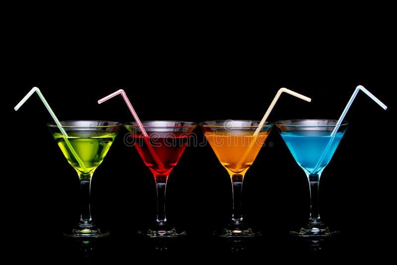 Cocktail coloridos de martini nos vidros imagens de stock royalty free