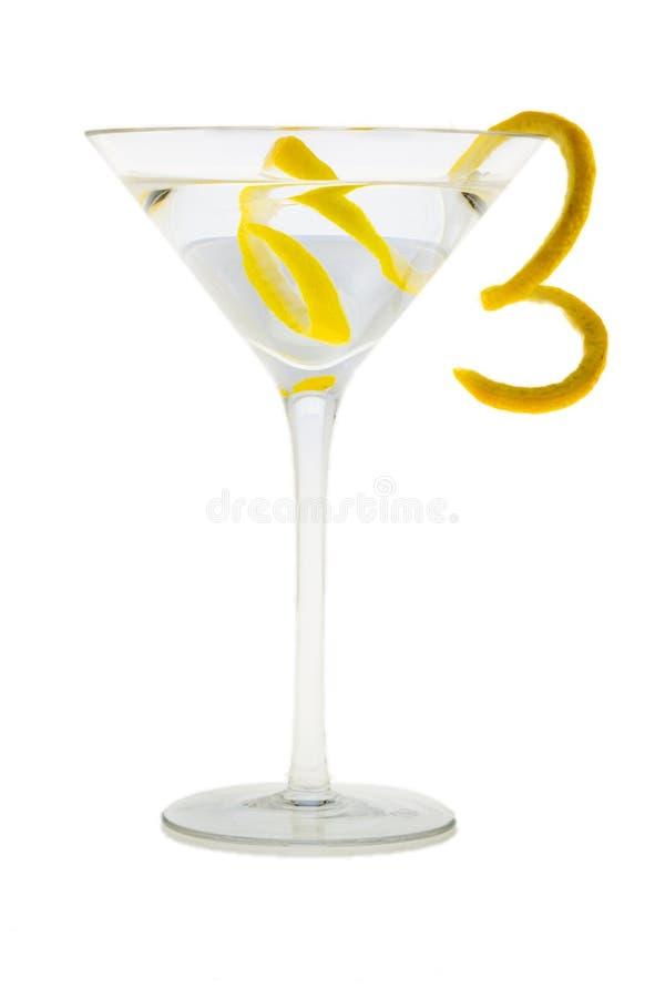 Cocktail de Martini com casca de limão fotos de stock royalty free