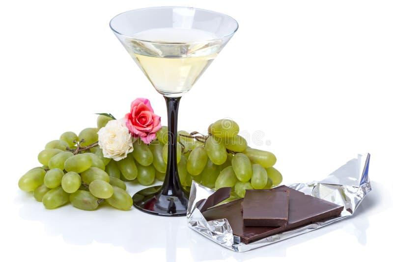 Cocktail di Martini con l'uva ed il cioccolato fotografia stock