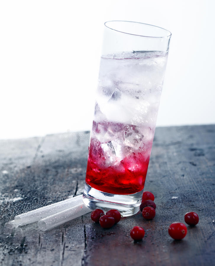 Cocktail Drink with grenadine. Standing on straws on a wooden vintage bar stock images